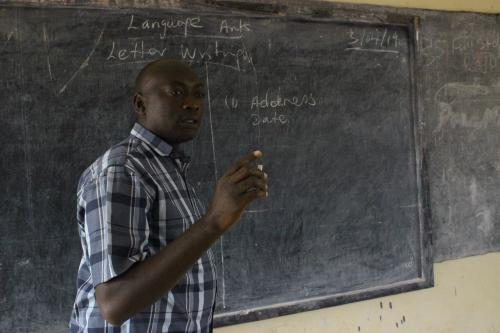 Abubakarr teaching in Class.