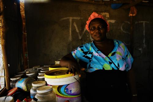 Isatu Turay Poses close to her wares that she sells.