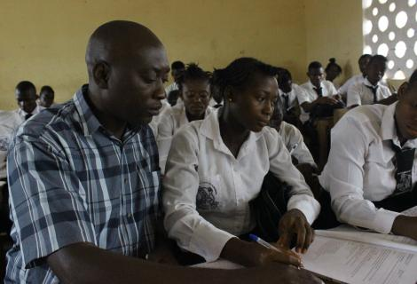 Abubakarr Sesay, Teacher Monitoring a Pupil during Class Work