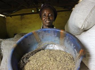 Kadiatu Kamara poses in the store with her seeds.