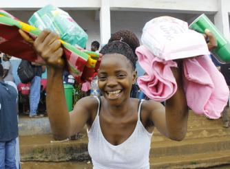 Christiana display her dignity Kits that is supplied by ActionAid